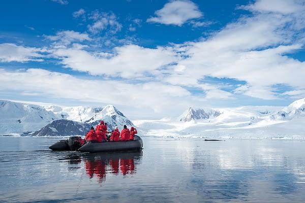 Inflatable boat full of tourists Antarctic Peninsula Antarctica